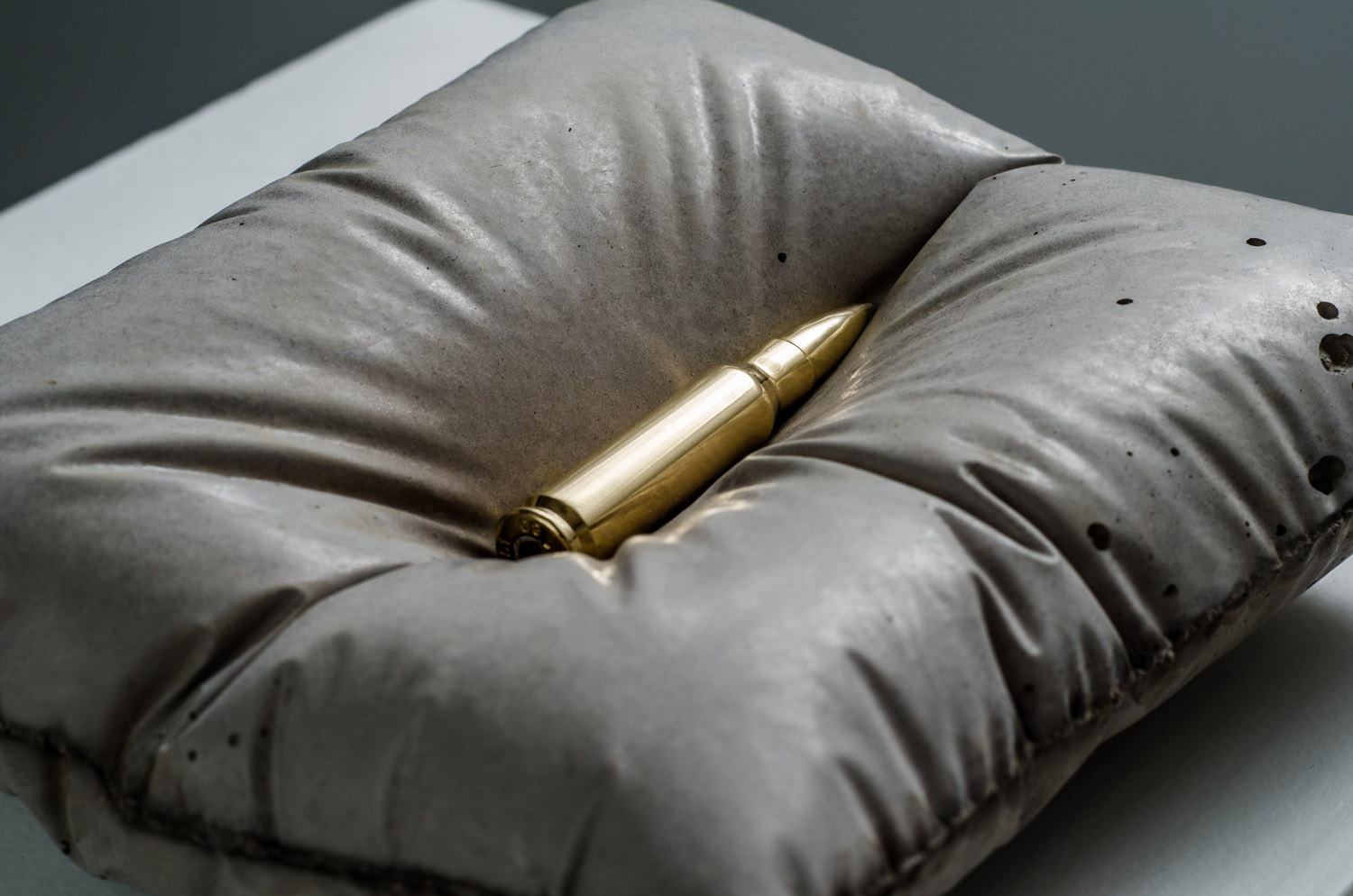 Gold bullet sculpture by Amarist Studio