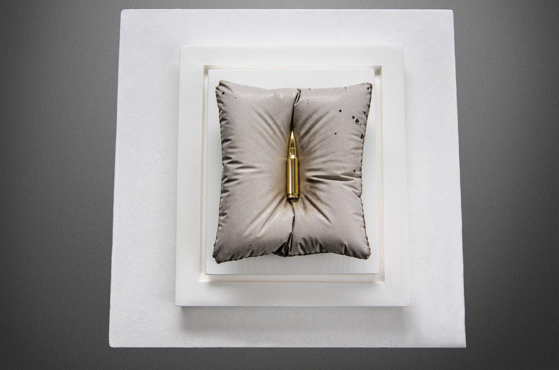 Gold bullet sculpture by Amarist Studio